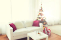 blurred living room with christmas tree background