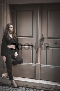 Beautiful woman in stylish black clothes