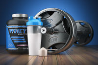 Barbell and whey protein shaker. Sports bodybuilding supplements or nutrition. Fitness or healthy lifestyle concept.