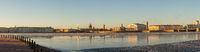 Panoramic view of the Spit of Vasilievsky island and the embankments of the Neva river early in the morning