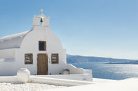 Traditional white orthodox church in Oia, Santorini, Greece.