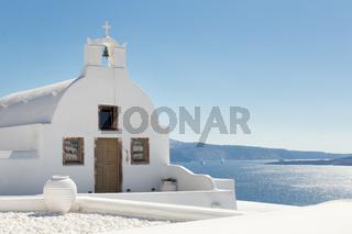 Traditional white orthodox church in Oia, Santorini, Greece.