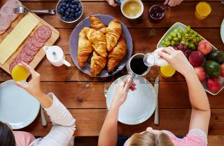 women having breakfast at table