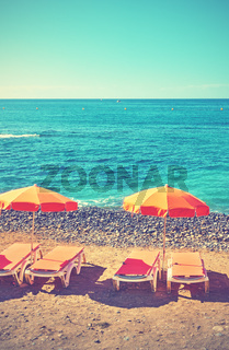 Umbrellas and chaise longues on a beach