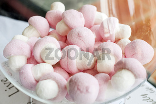 pink and white marshmallows in bowl