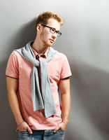 Young man on grey background.