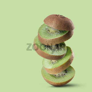 Falling slices of kiwi fruit isolated