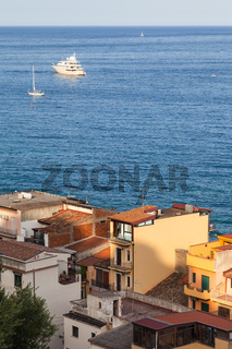 houses in Giardini Naxos town and ships in Sea
