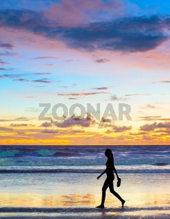 Woman walking at sunset. Bali