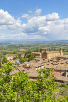View of San Gimignano and a rural landscape view in Tuscany, Italy