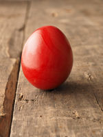 Colored Easter egg on wood