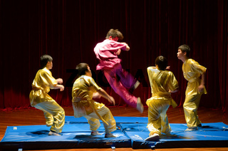 MACAU - APRIL 25: Performing Chinese kung fu (wu shu) with pose of kicking enemies