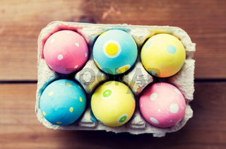 close up of colored easter eggs in egg box