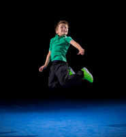 Little boy in sports hall isolated