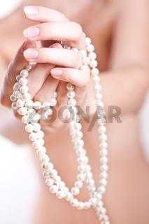 pearls in the women's hands