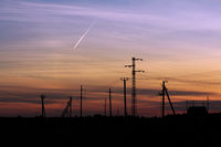 Pylon high voltage power line on sunset. Large towers of metal structures with electric wires on the sunset background.
