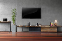 Living room led tv on concrete wall with wooden table media furniture