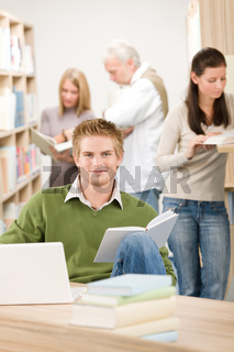 High school library - Student with book