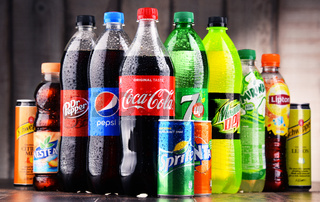 Bottles and cans of assorted global soft drinks