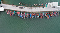 Aerial top view of tour and fishing boats morred on the pier in Pattaya