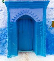 Old blue door on street in Chefchaouen