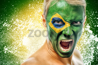 man with brazil flag painted on face