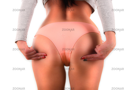 Sexy female buttocks isolated on white background. Weight loss