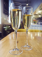 Two champagne glasses on the table at restaurant