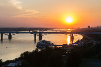 Beautiful sunset over the Octyabrsky bridge across river Ob in Novosibirsk