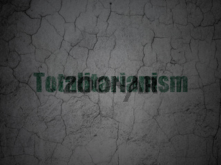 Political concept: Totalitarianism on grunge wall background