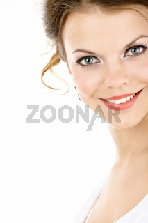 The portrait of smiling young woman isolated on a white background
