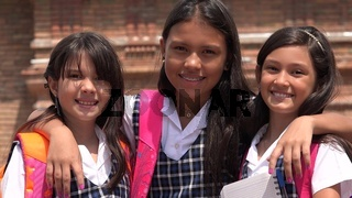 Pretty Female Students And Friendship Wearing School Uniforms