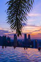 Pool on roof and Singapore city skyline