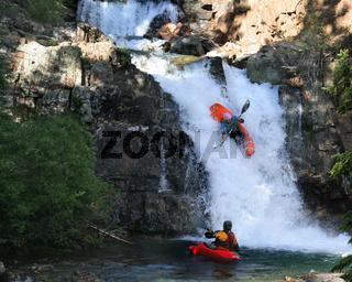 Kayaking On A Mountain Waterfall