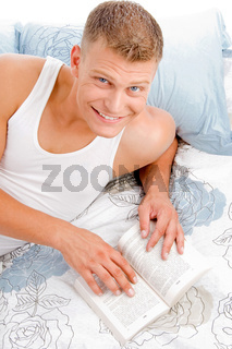 portrait of guy reading a book