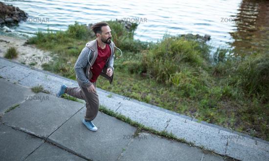 Man doing cardio workout outdoors.