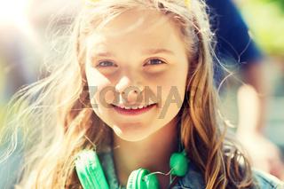 happy teenage girl with headphones