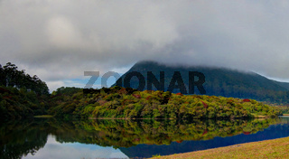 Reflection of Gregory lake in Nuwara Eliya in the fog, Sri Lanka