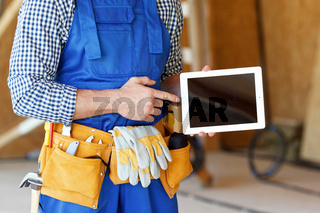 Worker pointing at tablet