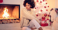 Lovely black woman in white leggings and sweater