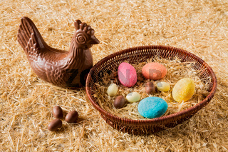 Easter chocolate eggs over the straw