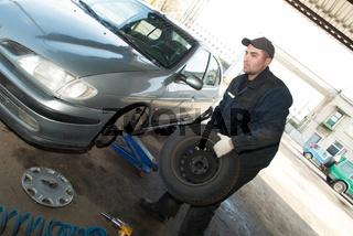 serviceman at tyre work