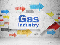 Manufacuring concept: arrow with Gas Industry on grunge wall background