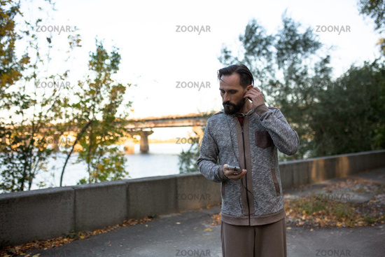 Man running in the morning listening music on phone.