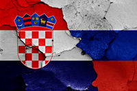 flags of Croatia and Russia painted on cracked wall