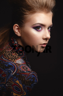 Portrait of beautiful young girl with glamorous evening makeup