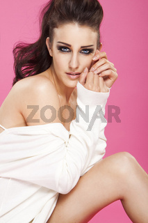 sexy glamour model posing on pink background