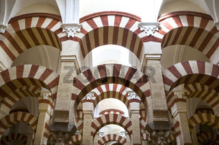 Double red-and-white colored arches inside Cordoba Mosque, Spain