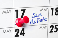 Wall calendar with a red pin - May 17
