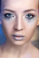 beautiful blond girl with sparkling makeup